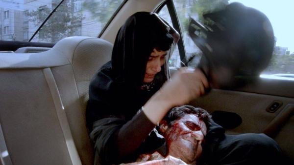 """Кадър от """"Такси"""" на забранения в родния си Иран Джафар Панахи"""